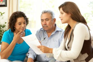 A woman and elderly parent meet with their POP Family Coach